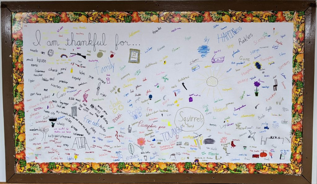 Bulletin board filled with items for which students are thankful